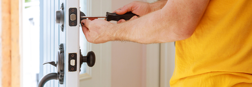 This is a photo of Serv-U locksmiths installing a deadbolt lock.
