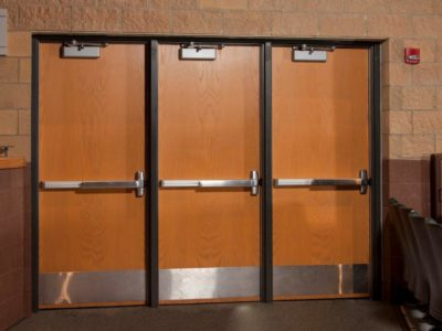 This Is A Photo Of Auditorium Doors With Panic Bars And Door Closers Installed