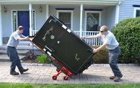 Serv-U Locksmith team delivering a safe